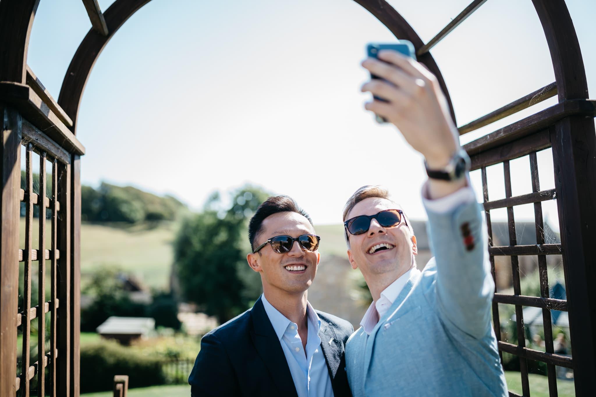 Guests at wedding taking selfie