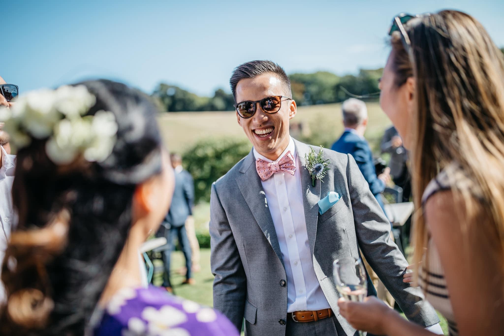 Groom at wedding laughing
