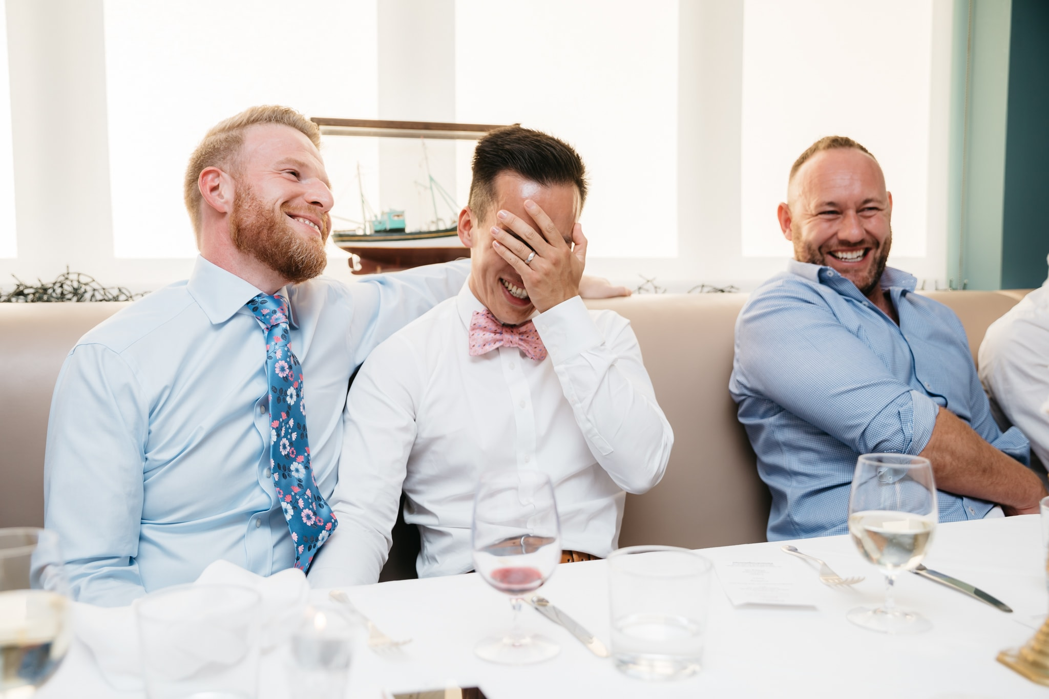 Gay couple laughing during speeches