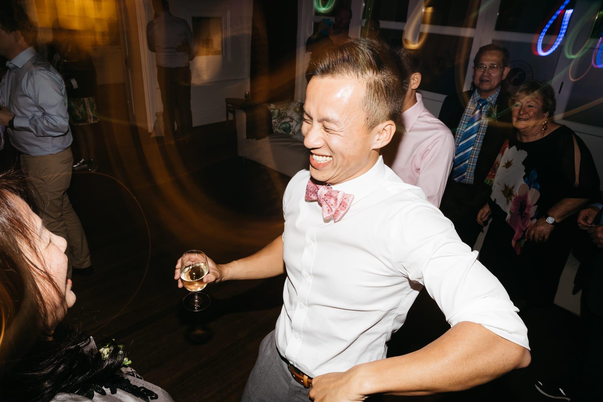 Groom dancing at wedding