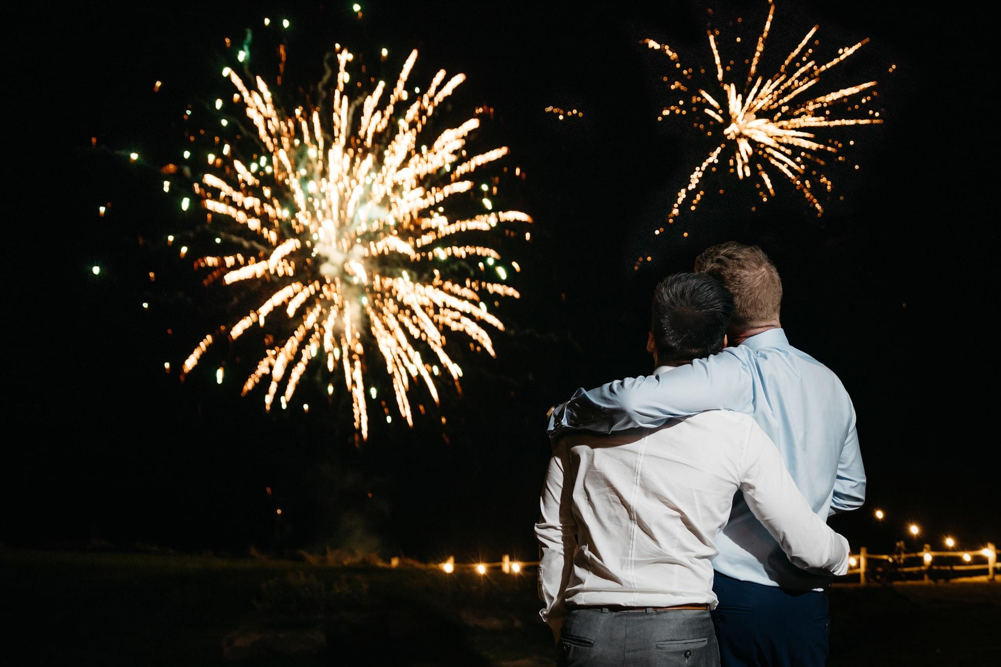 Same sex couple with wedding fireworks